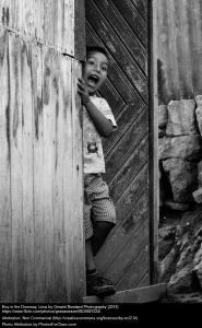 Boy in doorway, Lima