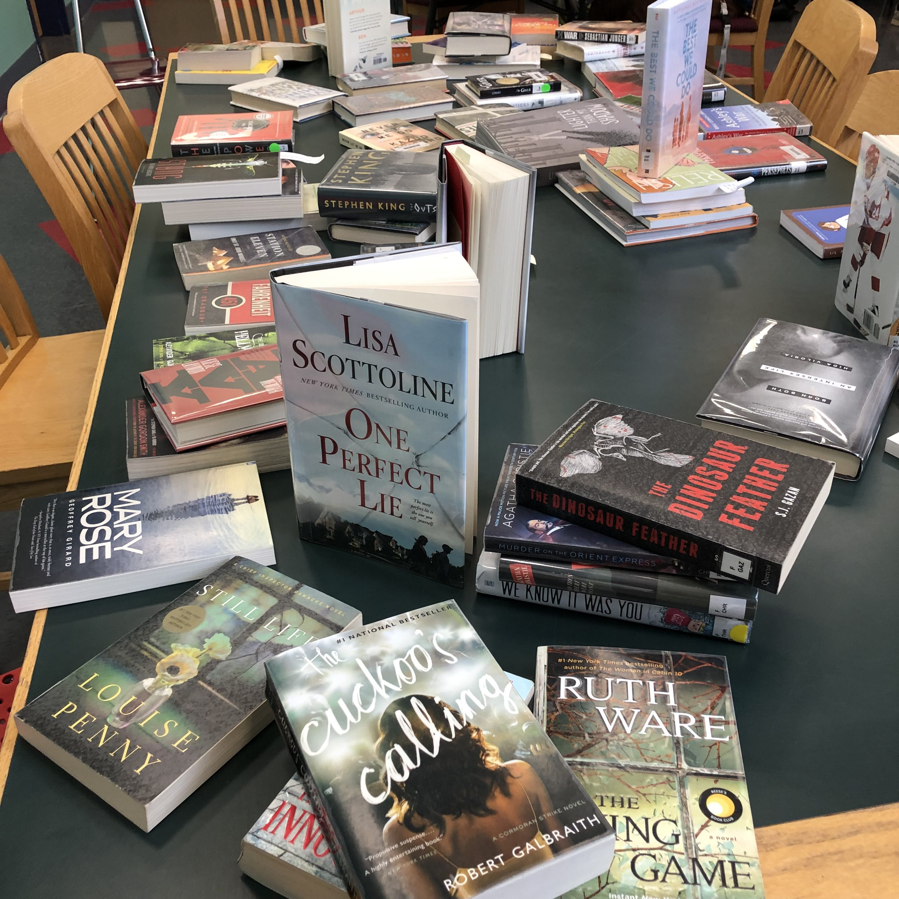A class came to browse some new titles. The photo shows what the display looked like after students had picked through them — a little messy! The theme was mysteries or thrillers for this class.