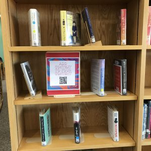Book display with QR code's on the spines of additional content links