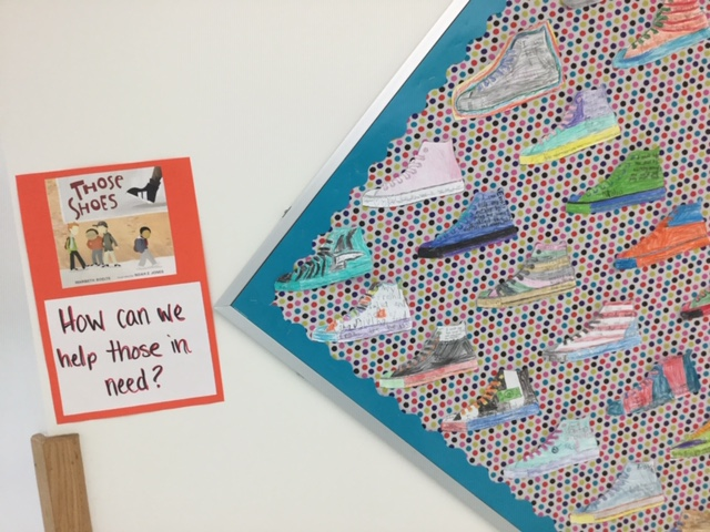 bulletin board with shoes and a caption: How can we help those in need?