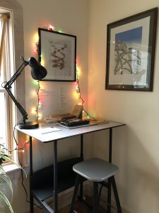 picture of a standing desk and at-home workspace