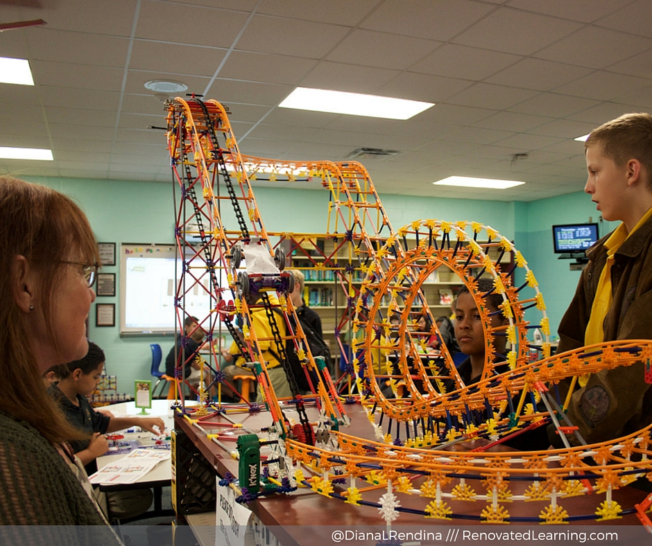 A student explains his K'nex roller coaster project to one of our teachers.