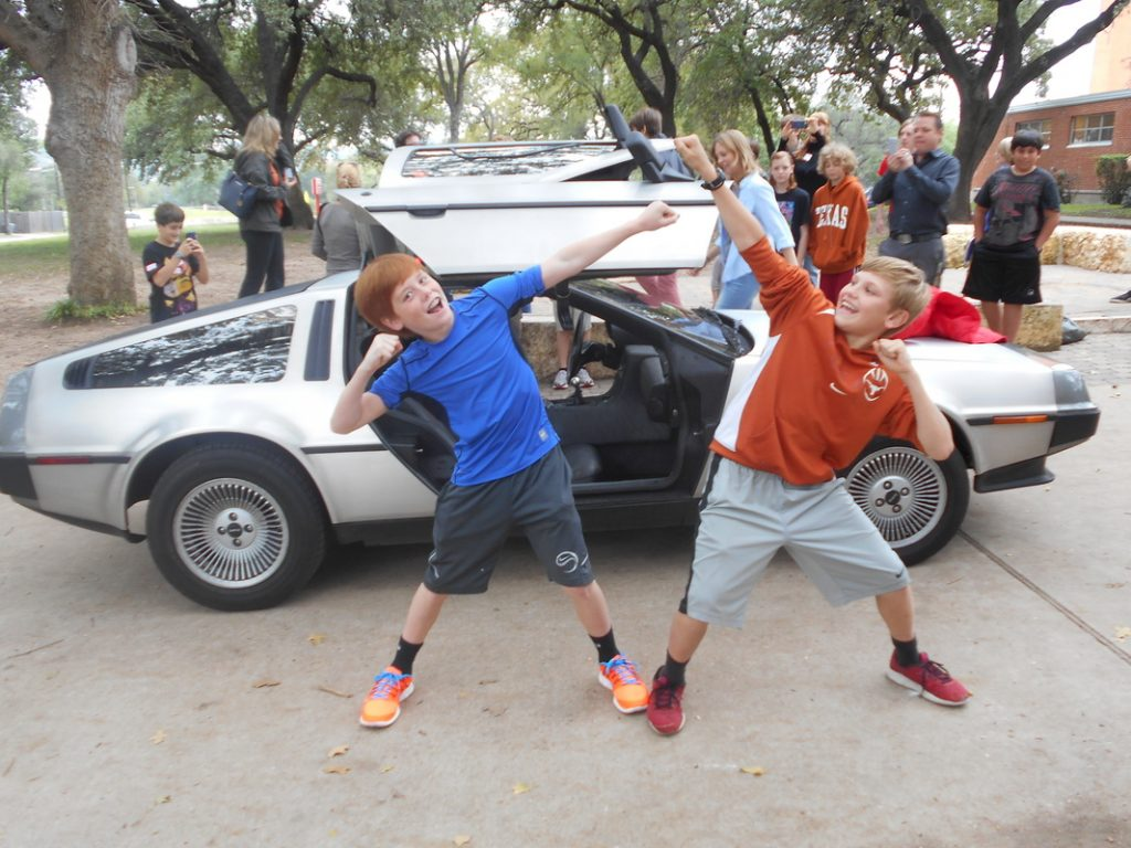 O. Henry students celebrate author Ernie Cline's visit in his DeLorean