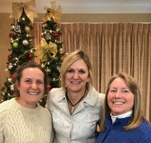 Two educators pictured with author Penny Kittle