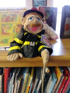 A Puppet in the Library