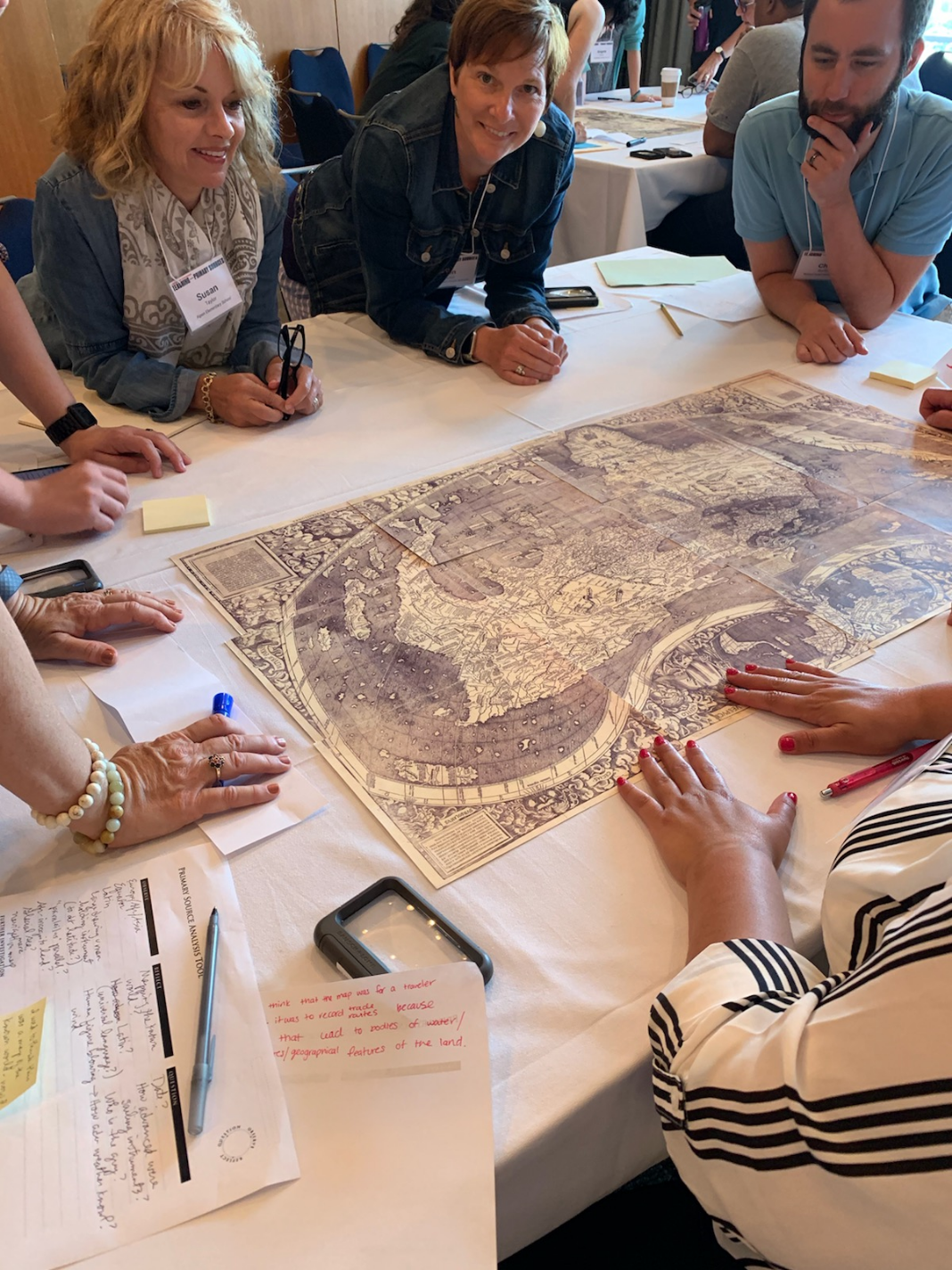 Participants working together around a primary source at the Library of Congress Teacher Institute