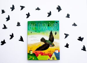 The cover of the book One Dark Bird by Liz Garton Scanlon and Frann Preston-Gannon