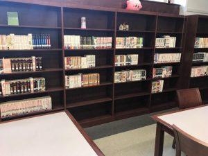 A library bookshelf containing volumes of manga.